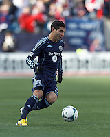 Sporting Kansas City midfielder Soony Saad (22) dribbles at midfield.  In a Major League Soccer (MLS) match, Sporting Kansas City (blue) tied the New England Revolution (white), 0-0, at Gillette Stadium on March 23, 2013.