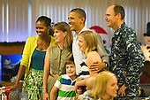 United States President Barack Obama and first lady Michelle Obama pose for a picture with unidentified members of the U.S. military and their families as they eat a Christmas Day meal at Anderson Hall mess hall at Marine Corps Base Hawaii on Sunday, December 25, 2011 in Kaneohe, Hawaii.  .Credit: Kent Nishimura / Pool via CNP