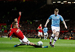 Brandon Williams of Manchester United intercepts Kevin De Bruyne of Manchester City during the Carabao Cup match at Old Trafford, Manchester. Picture date: 7th January 2020. Picture credit should read: Darren Staples/Sportimage