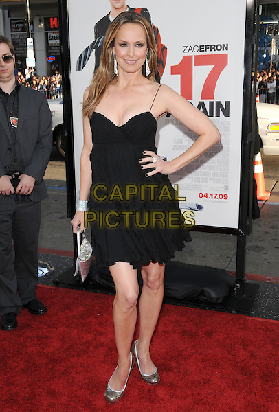 "MELORA HARDIN.The L.A. premiere of ""17 Again"" held at The Grauman's Chinese Theatre in Hollywood, California, USA. .April 14th, 2009.full length dress silver bag purse bracelet cuff pumps shoes hand on hip  black .CAP/DVS.©Debbie VanStory/Capital Pictures."