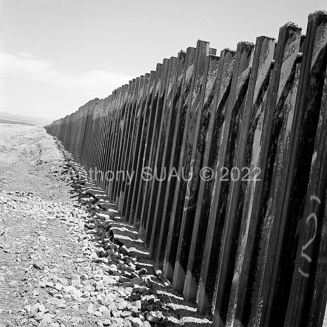 Naco, Arizona<br /> May 4, 2008<br /> <br /> In Naco new border fencing lines the US/Mexican border. The vast majority of the Arizona/Mexican border is now marked by vehicle barrier or high fencing. Also a graded road that runs along the fence and updated lighting are being put in place.