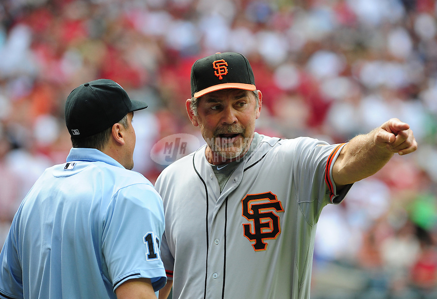 Apr. 8, 2012; Phoenix, AZ, USA; San Francisco Giants manager Bruce Bochy (right) argues with umpire Mike DiMuro after being ejected for arguing in the seventh inning against the Arizona Diamondbacks at Chase Field. Mandatory Credit: Mark J. Rebilas-
