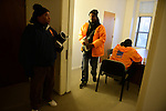 """Cease Fire (l-r) supervisor Ulysses """"US"""" Floyd and outreach workers and violence interrupters James Sima, 39, and Donya Smith, 26, wrapping up a briefing in their office on recent developments in the neighborhoods where they work with at risk youth participants on the far South Side of Chicago, Illinois on February 3, 2017.  Cease Fire is a public health initiative that attempts to stop or halt gun violence across the city."""