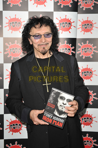 Tony Iommi.Signing copies of his new biography 'Iron Man' at Fopp Records, Covent Garden, London, England..17th October 2011.half length black suit jacket top gold necklace cross crucifix tinted glasses goatee facial hair book.CAP/MAR.© Martin Harris/Capital Pictures.