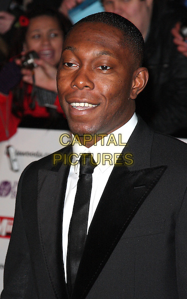 DIZZEE RASCAL (Dylan Kwabena Mills) .Attending the Pride of Britain Awards 2010, Grosvenor House, Park Lane, London, England, UK, .November 8th 2010..arrivals portrait headshot black suit tie white shirt smiling .CAP/ROS.©Steve Ross/Capital Pictures.