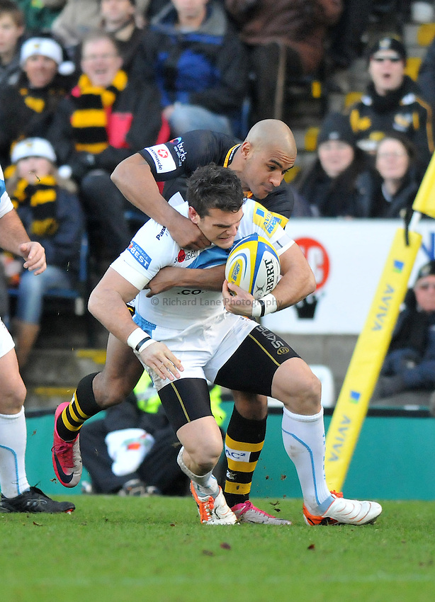 Photo: Tony Oudot/Richard Lane Photography. London Wasps v Exeter Chiefs. Aviva Premiership. 05/12/2010. .Exeter's Mark Foster is tackled by Tom Varndell for Wasps.
