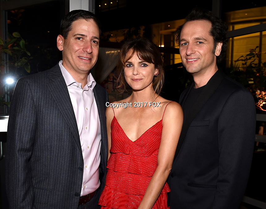 LOS ANGELES, CA - SEPTEMBER 16: (L-R) Eric Schrier, Keri Russell and Matthew Rhys attend the FX Networks and Vanity Fair 2017 Primetime Emmy Nominee Celebration at Craft LA on September 16, 2017 in Los Angeles, California. (Photo by Frank Micelotta/FX/PictureGroup)