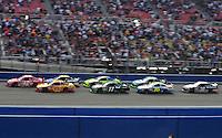 Oct. 11, 2009; Fontana, CA, USA; NASCAR Sprint Cup Series driver Juan Pablo Montoya (42) leads Kevin Harvick (29) during the Pepsi 500 at Auto Club Speedway. Mandatory Credit: Mark J. Rebilas-