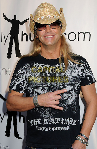 "BRET MICHAELS of Poison.Singer Bret Michaels is in critical condition suffering from a brain hemorrhage, his publicist Joann Mignano said. Michaels the former Poison frontman was rushed to intensive care late Thursday after a severe headache. Doctors discovered bleeding at the base of his brain stem. The 47-year-old glam-rock reality TV star had an emergency appendectomy at a private care facility for diabetics last week after complaining of stomach pains before he was scheduled to perform in San Antonio, Texas. Michaels is currently a contestant on the third season of Donald Trump's NBC competitive reality show, ""The Celebrity Apprentice."" Trump said in a statement Friday that he was ""deeply saddened"" to hear of Michaels' condition - USA - 23rd April 2010..File Photo: 2nd Annual Game Day at the Playboy Mansion, Los Angeles, CA1st February 2009..half length sunglasses black and white t-shirt smiling hand rock gesture cowboy hat bracelets .CAP/ADM/BP.©Byron Purvis/AdMedia/Capital Pictures."