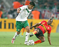 Miloy (6) of Angola slides in on Carlos Salcido (3) of Mexico. Mexico and Angola played to a 0-0 tie in their FIFA World Cup Group D match at FIFA World Cup Stadium, Hanover, Germany, June 16, 2006.