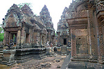 Angkorian temple Banteay Srei (late 10th century) 967.<br /> Mandapa on the left .Doorway into northern tower sanctuary.Part of the east side of the northern library.<br /> Banteay Srei temple has three sanctuary towers.The central sanctuary and the southern sanctuary were dedicated to Shiva and the northern sanctuary was dedicated to Vishnu.<br /> Banteay Srei temple is situated 20km north of Angkor, built during the reign of Rajendravarman by Yajnavaraha, one of his counsellors. In antiquity Isvarapura was a small city that grew up around the temple. Banteay Srei was dedicated to the worship of Shiva, the foundation stele describes the consecration of the linga Tribhuvanamahesvara (Lord of the three worlds) in 967.