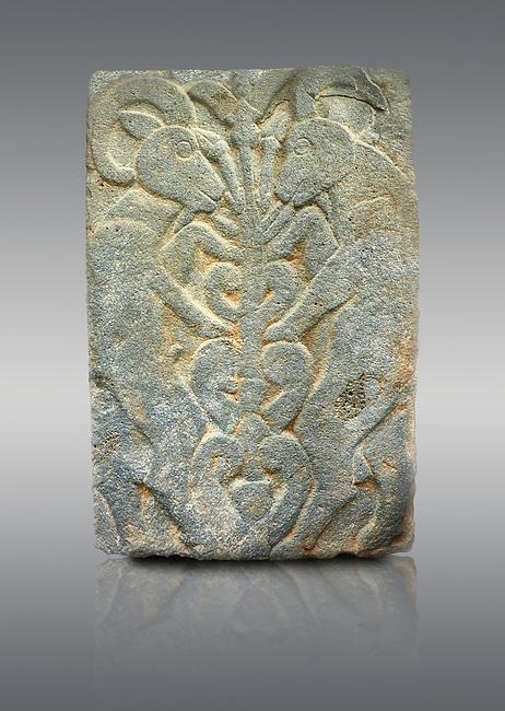 Pictures & images of the North Gate Hittite sculpture stele depicting Hittite mythical animal Gods. 8th century BC. Karatepe Aslantas Open-Air Museum (Karatepe-Aslantaş Açık Hava Müzesi), Osmaniye Province, Turkey. Against grey background