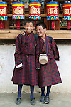The mountainous Kingdom of Bhutan is purportedly the happiest place on Earth.  Hardly wealthy, Bhutan's citizens are peaceful and in harmony with each other like these two boys sharing laughter in the Paro Valley.