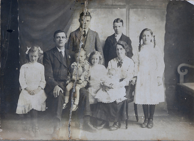 Restore old photos - ripping, water damage, fading and missing edges - before restoration