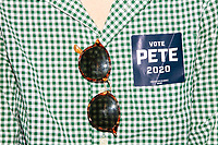 """A person wears a """"Vote Pete 2020"""" sticker during the opening of a new campaign office for Democratic presidential candidate and South Bend, Ind., mayor Pete Buttigieg, in Concord, New Hampshire, on Thu., September 5, 2019."""