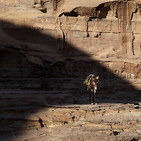 Donkey on the path to the Monastery or Al Deir Temple,  Petra, Ma'an, Jordan. Petra was the capital and royal city of the Nabateans, Arabic desert nomads. Picture by Manuel Cohen