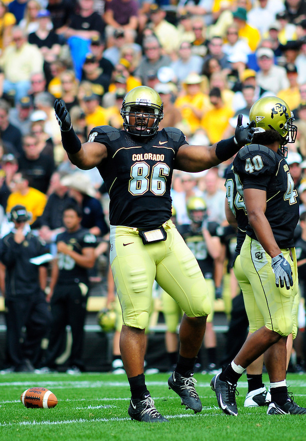 06 September 08: Colorado defensive tackle George Hypolyte tries to rally the crowd during a game against Eastern Washington. The Colorado Buffaloes defeated the Eastern Washington Eagles 31-24 at Folsom Field in Boulder, Colorado. FOR EDITORIAL USE ONLY