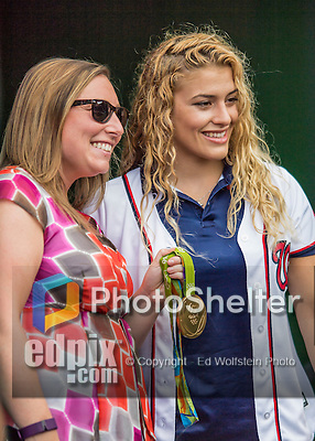25 August 2016: Washington Nationals Senior Director of Communications Amanda Comak holds the hardware, standing with 2016 Olympic Gold medal winner for the USA in women's wrestling Helen Maroulis, prior to a game between the Baltimore Orioles and the Washington Nationals at Nationals Park in Washington, DC. The Nationals blanked the Orioles 4-0 to salvage one game of their 4-game home and away series. Mandatory Credit: Ed Wolfstein Photo *** RAW (NEF) Image File Available ***