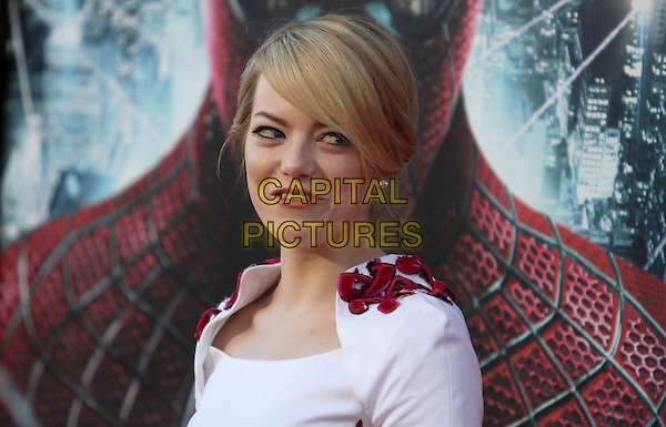 "Emma Stone.Los Angeles Premiere Of ""The Amazing Spider-Man"" Held The at Regency Village Theatre, Westwood, California, USA..June 28th, 2012.headshot portrait white pink floral embroidered funny mouth open.CAP/ADM/FS.©Faye Sadou/AdMedia/Capital Pictures."