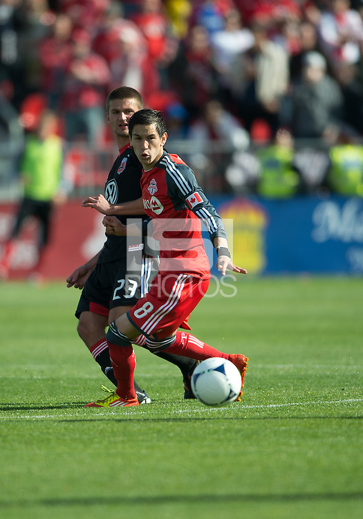 05 May 2012: D.C. United defender Perry Kitchen #23 and Toronto FC midfielder Eric Avila #8 in action during an MLS game between DC United and Toronto FC at BMO Field in Toronto..D.C. United won 2-0.