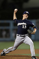 Zack Greinke #13 of the Milwaukee Brewers pitches against the Los Angeles Dodgers at Dodger Stadium on May 31, 2012 in Los Angeles,California. Milwaukee defeated Los Angeles 6-2.(Larry Goren/Four Seam Images)