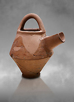 Hittite terra cotta side spout with stainer basket handles pitcher . Hittite Period, 1600 - 1200 BC.  Hattusa Boğazkale. Çorum Archaeological Museum, Corum, Turkey. Against a grey bacground.