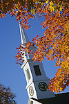 Autumn Colors in Front of a White Church Steeple
