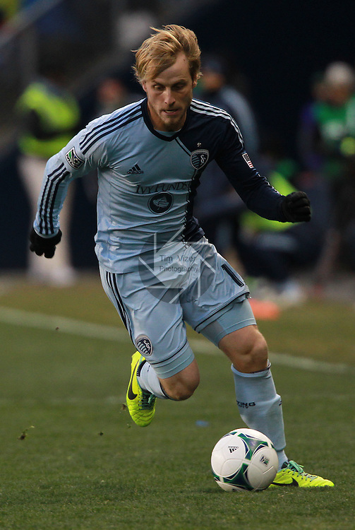 Sporting KC defender Seth Sinovic (15) dribbles downfield in the second half. Sporting KC defeated Real Salt Lake in a shootout after the score was tied 1-1 at the end of regulation play in the MLS Cup 2013 championship held at Sporting Park in Kansas City, Kansas on Saturday December 7, 2013.