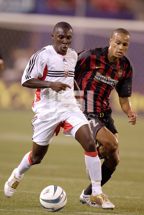 D.C. United's Freddy Aduis marked by the MetroStars' Ricardo Clark. D.C. United defeated the MetroStars 1 to 0 in regular season MLS action on Saturday October 2, 2004 at Giant's Stadium, East Rutherford, NJ..
