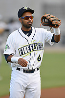 Second baseman Giovanny Alfonzo (6) of the Columbia Fireflies warms up before a game against the Charleston RiverDogs on Wednesday, August 29, 2018, at Spirit Communications Park in Columbia, South Carolina. Charleston won, 6-1. (Tom Priddy/Four Seam Images)