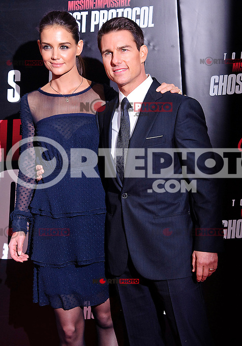 """Katie Holmes and Tom Cruise at The U.S. Premiere of """"Mission Impossible-Ghost Protocol"""" held at the Ziegfeld Theater. December 19, 2011. © mpi17/MediaPunch Inc."""