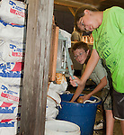 Photo by Phil Grout..If Justin Shipley thinks he's tired now cutting French fries, wait'll he finishes.with that whole stack of spuds he and Lane Logue-Ruckman are working with.at a food concession at the 4-H Fair.