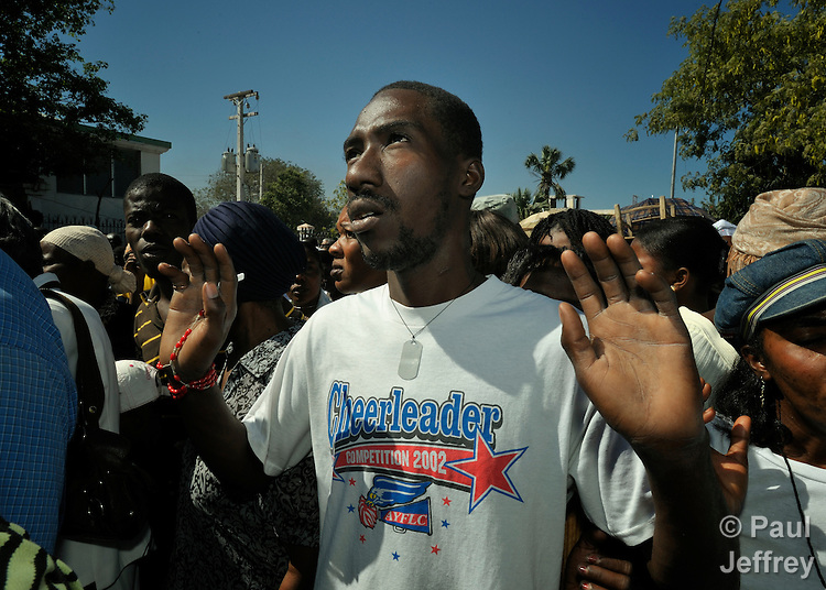 A man prays during a Catholic mass in Port-au-Prince marking the one-year anniversary of the January 12, 2010, earthquake that devastated Haiti. Held in the shadows of the ruins of the city's Catholic cathedral, the gathering was one of many special observances held throughout the Caribbean nation...