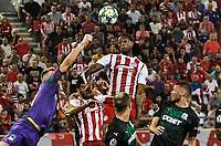 Krasnodar's goalkeeper Safonov takes the ball infront of Olympiakos Ruben Semedo (R)during the UEFA Champions League playoff first leg soccer match between Olympiakos and Krasnodar at Karaiskaki stadium in Piraeus, Greece, on 21 August 2019