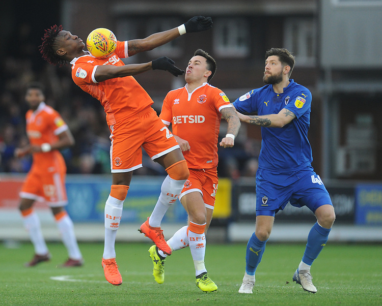 Blackpool's Armand Gnanduillet controls the ball as John O'Sullivan fends off AFC Wimbledon's Anthony Wordsworth<br /> <br /> Photographer Kevin Barnes/CameraSport<br /> <br /> The EFL Sky Bet League One - AFC Wimbledon v Blackpool - Saturday 29th December 2018 - Kingsmeadow Stadium - London<br /> <br /> World Copyright © 2018 CameraSport. All rights reserved. 43 Linden Ave. Countesthorpe. Leicester. England. LE8 5PG - Tel: +44 (0) 116 277 4147 - admin@camerasport.com - www.camerasport.com