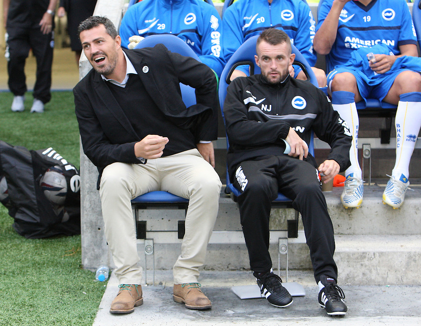 L-R Brighton and Hove Albion's Manager Oscar Garcia  and Assiatant Head Coach Nathan Jones before kick off<br /> (Photo by Kieran Galvin/CameraSport<br /> <br /> Football - Capital One Cup First Round - Brighton and Hove Albion v Newport County - Tuesday 6th August 2013 - American Express Community Stadium - Brighton<br />  <br /> &copy; CameraSport - 43 Linden Ave. Countesthorpe. Leicester. England. LE8 5PG - Tel: +44 (0) 116 277 4147 - admin@camerasport.com - www.camerasport.com
