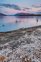 Pumice along the shore of Naknek lake, Mount Katolinat of the Kejulik mountains in the distance, Katmai National Park, southwest, Alaska.