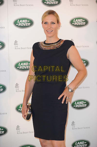 Zara Phillips.The All New Range Rover launch at the Royal Ballet School in Richmond Park, London, England..6th September 2012.half length hand on hip gold clutch bag silver collar black dress .CAP/CAS.©Bob Cass/Capital Pictures.
