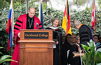 President Jonathan Veitch and Trustee John Power '58 confer an Honorary Degree to speaker Ann Kerr-Adams '56<br />