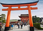 Torii in front of the Main gate, Romon, busy with tourists at Fushimi Inari Taisha head shrine in Fushimi Ward, Kyoto, Japan 2017