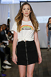 Child model walks runway in an outfit from the Izzy Be Boutique Clothing Line by Isabella Brown, during the KidFash Magazine runway show in Brooklyn, New York on Nov 4, 2017.