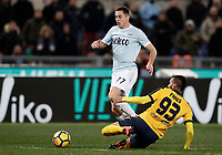 Calcio, Serie A: SS Lazio vs Hellas Verona, Roma, stadio Olimpico, 19 febbraio 2018.<br /> Lazio's Adam Marusic (l) in action with Verona's Mohamed Fares (r) during the Italian Serie A football match between SS Lazio and Hellas Verona at Rome's Olympic stadium, February 19, 2018.<br /> UPDATE IMAGES PRESS/Isabella Bonotto
