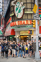 Throngs of tourists pass a Mama Sbarro's restaurant in Times Square in New York on Tuesday, June 10, 2014. Once again Sbarro has exited bankruptcy for the second time and it is moving its headquarters from Melville, NY to Columbus, OH. (© Richard B. Levine)
