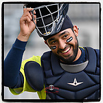 Catcher Ali Sanchez (7) of the Columbia Fireflies pulls off his facemask at the end of a warmup before a game against the Greenville Drive on Friday, May 25, 2018, at Spirit Communications Park in Columbia, South Carolina. Columbia won, 3-1. (Tom Priddy/Four Seam Images)