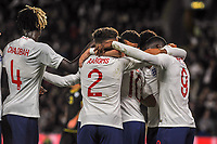 England Under 21's midfielder Phil Foden (10) swamped by team mates after opening goal during the UEFA Euro U21 Qualifying match between England U21 & Kosovo U21 at KCOM Craven Park, Hull, England on 9 September 2019. Photo by Stephen Buckley / PRiME Media Images.