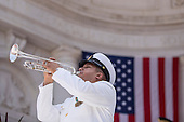 A member of the United States Navy plays 'Taps' after U.S. President Barack Obama delivered remarks during a Memorial Day event at Arlington National Cemetery, May 26, 2014 in Arlington, Virginia. President Obama returned to Washington Monday morning after a surprise visit to Afghanistan to visit U.S. troops at Bagram Air Field.<br /> Credit: Drew Angerer / Pool via CNP