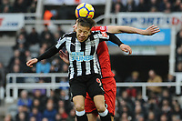 Dwight Gayle of Newcastle United battles with Wesley Hoedt of Southampton during Newcastle United vs Southampton, Premier League Football at St. James' Park on 10th March 2018