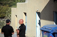 FAO JANET TOMLINSON, DAILY MAIL PICTURE DESK<br /> Pictured: Police officers in front of the house where Ben Needham disappeared from, part of which (FAR LEFT) will be demolished for the search in Kos, Greece. Monday 03 October 2016<br /> Re: Police teams led by South Yorkshire Police, searching for missing toddler Ben Needham on the Greek island of Kos have moved to a new area in the field they are searching.<br /> Ben, from Sheffield, was 21 months old when he disappeared on 24 July 1991 during a family holiday.<br /> Digging has begun at a new site after a fresh line of inquiry suggested he could have been crushed by a digger.