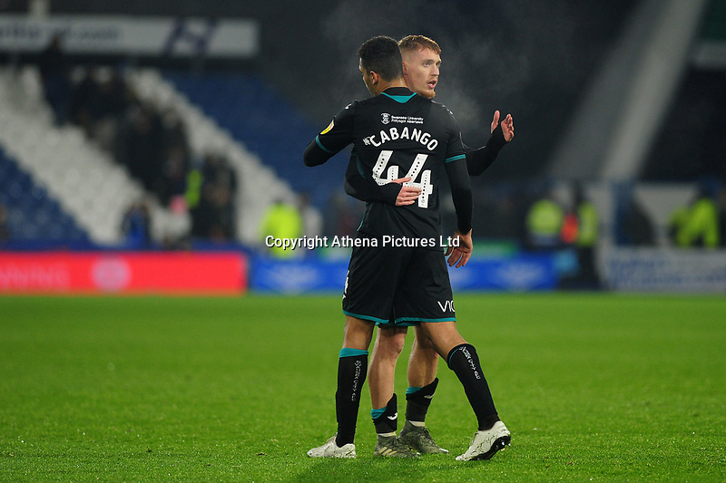 Ben Cabango shakes hands with Jay Fulton of Swansea City at full time during the Sky Bet Championship match between Huddersfield Town and Swansea City at The John Smith's Stadium in Huddersfield, England, UK. Tuesday 26 November 2019