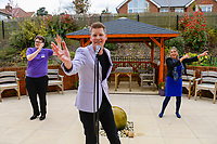 BNPS.co.uk (01202 558833)<br />Pic: Graham Hunt/BNPS<br /><br />Singer Steve Linn entertains the residents of Ferndown Manor Care Home from the garden as they sit inside behind the windows.<br /> <br /> Thinking outside the box - A hero singer has been performing in the gardens of elderly care home residents in a bid to boost morale amid the coronavirus pandemic.<br /> <br /> Steve Linn, from Bournemouth in Dorset has been putting on the spirit raising shows at around 40 centres across the south coast.<br /> <br /> With the pensioners in lockdown following government advice he has been singing from outside their rooms, keeping them entertained.<br /> <br /> Mr Linn, 38, says his list of 250 songs are proving a huge hit with his elderly audiences as well as staff at the care homes.<br /> <br /> The performer began singing at old folks homes around two years ago but was left fearing for his livelihood by the outbreak of COVID-19.<br /> <br /> Due to the risk to over 70s most of his gigs were cancelled, leaving him without his main source of income.<br /> <br /> However, he quickly came up with the idea of singing to residents from outside their rooms and his bookings have since sky-rocketed.